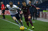 (L-R) Tom Clarke of Preston North End challenges Bersant Celina of Swansea City during the Sky Bet Championship match between Preston North End and Swansea City at Deepdale, Preston, England, UK. Saturday 12 January 2019