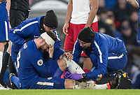 Olivier Giroud of Chelsea holds his head as he is treated for a second injury during the Premier League match between Chelsea and West Bromwich Albion at Stamford Bridge, London, England on 12 February 2018. Photo by Andy Rowland.