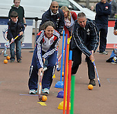 This image is free to use  Vicky Bunce (GB Hockey International and Dundee Wanderers) and Willie Marshall (Scotland and Kelburne) lead off the npower Big Dribble in George Square - Glasgow - on the first day of the 40 venue event for hockey whereby members of the public come and dribble a 100m course and sign a giant hockey ball while finding out a bit more about hockey and promoting the GB international teams ahead of the Olympic Games - for further information please contact Lawrence West of GB Hockey on 07525 987283 - Picture by Donald MacLeod  15.4.12  07702 319 738