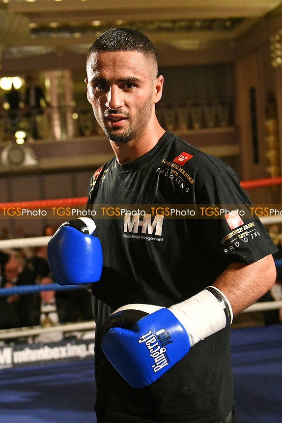 Siar Ozgul defeats Fonz Alexander during a Boxing Show at Park Lane Hotel on 26th May 2016