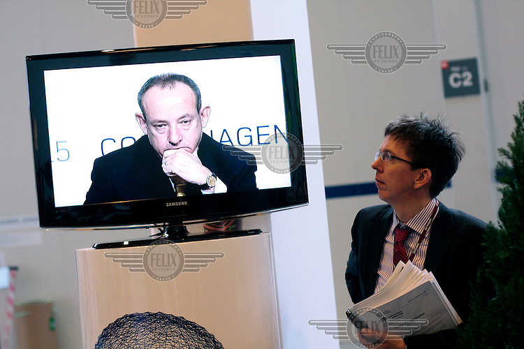 UN climate chief Yvo de Boer being watched on a TV in the conference center. United Nations Climate Change Conference (COP15) was held at Bella Center in Copenhagen from the 7th to the 18th of December, 2009. A great deal of groups tried to voice their opinion and promote their cause in various ways. The conference and demonstrations was covered by thousands of photographers and journalists from all over the world...©Fredrik Naumann/Felix Features.