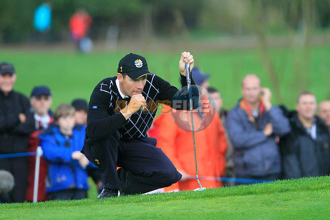 Padraig Harrington lines up his putt on the 17th green in the Session 3 Foursomes and Fourball Matches during Day 3 of the The 2010 Ryder Cup at the Celtic Manor, Newport, Wales, 3rd October 2010..(Picture Eoin Clarke/www.golffile.ie)