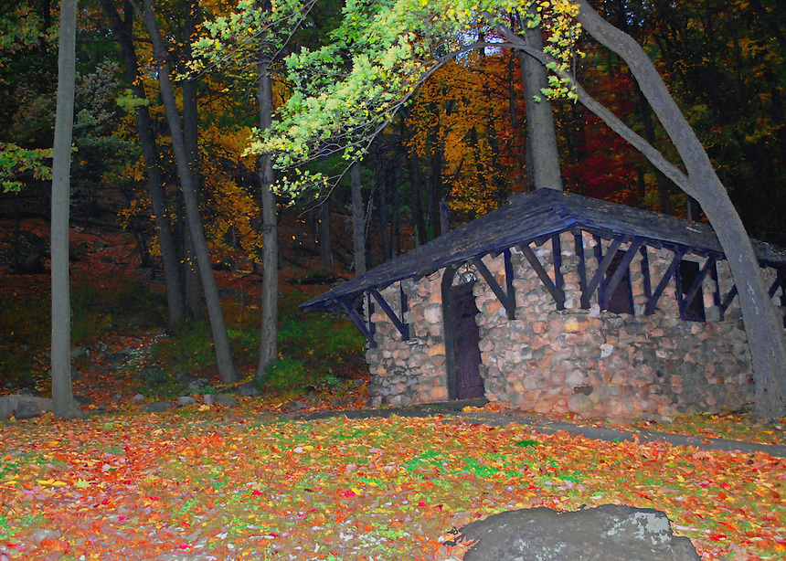 Solitude of a stone cabin in the woods.