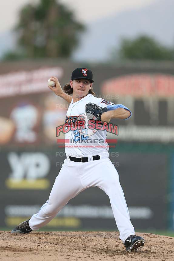 Mike Clevinger #22 of the Inland Empire 66ers pitches against the Modesto Nuts at San Manuel Stadium on May 28, 2014 in San Bernardino, California. Modesto defeated Inland Empire, 3-2. (Larry Goren/Four Seam Images)