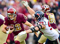 Landover, MD - November 18, 2018: Washington Redskins quarterback Colt McCoy (12) is sacked by Houston Texans defensive end J.J. Watt (99) during second half action of game between the Houston Texans and the Washington Redskins at FedEx Field in Landover, MD. The Texans defeated the Redskins 23-21. (Photo by Phillip Peters/Media Images International)