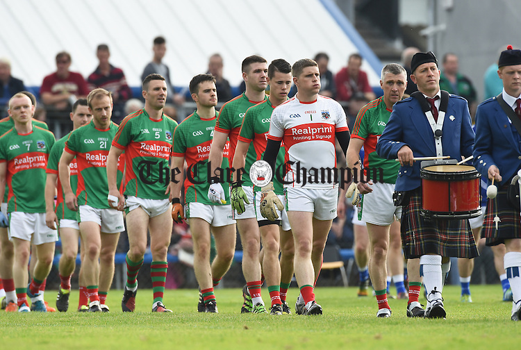 Kilmurry Ibrickane march behind the band before their county final against Cratloe in Cusack park. Photograph by John Kelly.