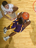 Jan. 2, 2011; Charlottesville, VA, USA; LSU Tigers forward Malcolm White (5) shoots the ball in front of Virginia Cavaliers forward Will Sherrill (22) during the game at the John Paul Jones Arena. Virginia won 64-50. Mandatory Credit: Andrew Shurtleff-