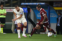 Edin Dzeko of AS Roma and Lyanco of Torino FC compete for the ball during the Serie A football match between Torino FC and AS Roma  at Olimpico stadium in Roma (Italy), July 29th, 2020. Play resumes behind closed doors following the outbreak of the coronavirus disease. Photo Gino Mancini / Insidefoto