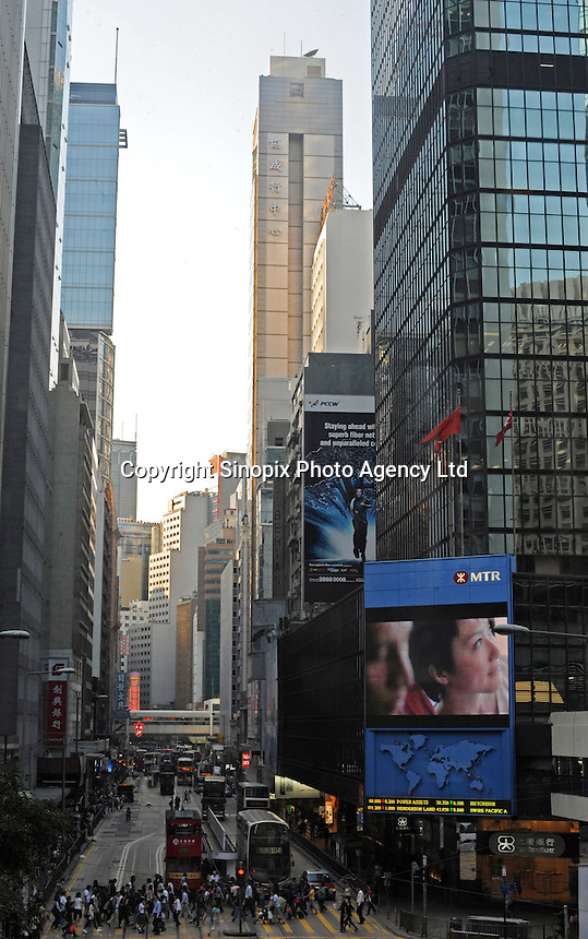 Trams and big screens on Des Voeux Road in Central business district, Hong Kong................