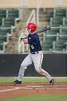 Matt Reistetter (15) of the Hagerstown Suns follows through on his swing against the Kannapolis Intimidators at CMC-Northeast Stadium on July 19, 2015 in Kannapolis, North Carolina.  The Suns defeated the Intimidators 9-4.  (Brian Westerholt/Four Seam Images)