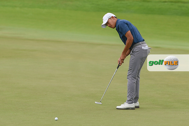 Lloyd Jefferson GO (PHI) watches his putt on 18 during Rd 4 of the Asia-Pacific Amateur Championship, Sentosa Golf Club, Singapore. 10/7/2018.<br /> Picture: Golffile   Ken Murray<br /> <br /> <br /> All photo usage must carry mandatory copyright credit (© Golffile   Ken Murray)