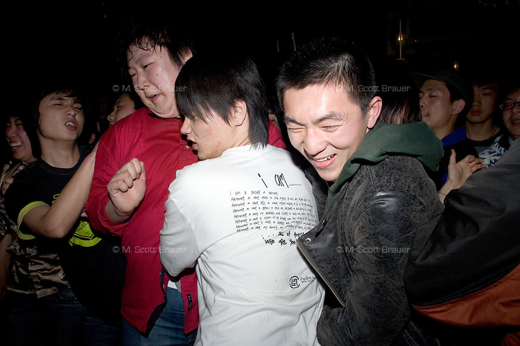 Punk fans slam dance and mosh during a concert at Castle Bar in Nanjing, China.