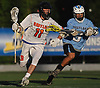 Zach Amelia #11 of Babylon, left, gets pressured by Brian Eng #9 of Westlake during the NYSPHSAA varsity boys lacrosse Class D state semifinals at Adelphi University in Garden City, NY on Wednesday, June 7, 2017. Babylon fell to Westlake 11-10 in overtime.