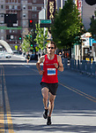 Zack Yeager heads towards the finish line of the 5K run during the Downtown River Run on Sunday, April 30, 2017 in Reno, Nevada.  Yeager won the 5K race.