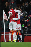 Mohamed Elneny of Arsenal (right) celebrates with Olivier Giroud of Arsenal after he scores his team's sixth goal of the game to make the score 6-0 during the UEFA Europa League match between Arsenal and FC BATE Borisov  at the Emirates Stadium, London, England on 7 December 2017. Photo by David Horn.