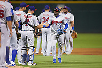 Jonathan Davis (1) of the Buffalo Bisons slaps hands with his teammates following their win over the Charlotte Knights at BB&T BallPark on July 24, 2019 in Charlotte, North Carolina. The Bisons defeated the Knights 8-4. (Brian Westerholt/Four Seam Images)