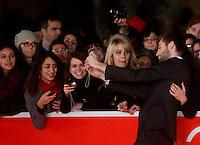 """L'attore e modello inglese Douglas Booth saluta i fans sul red carpet per la presentazione del film """"Romeo and Juliet"""" all'ottava edizione del Festival Internazionale del Film di Roma, 11 novembre 2013.<br /> British actor and model Douglas Booth greets fans as he walks on the red carpet to present the movie """"Romeo and Juliet"""" during the 8th edition of the international Rome Film Festival at Rome's Auditorium, 11 November 2013.<br /> UPDATE IMAGES PRESS/Riccardo De Luca"""