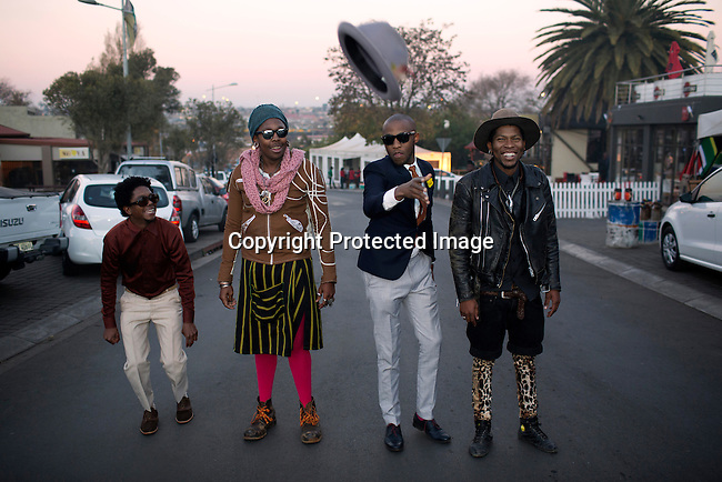 SOWETO, SOUTH AFRICA JULY 4: Members of the designer group Smarteez poses for pictures on July 4, 2014 in Vilakazi street in the Orlando section of Soweto, South Africa. From left, Teekay Makwale, Sibu Sithole, Lethabo Tsatsinyane and Floyd Avenue. Soweto today is a mix of old housing and newly constructed townhouses. A new hungry black middle-class is growing steadily. Many residents work in Johannesburg but the last years many shopping malls have been built, and people are starting to spend their money in Soweto. (Photo by: Per-Anders Pettersson)