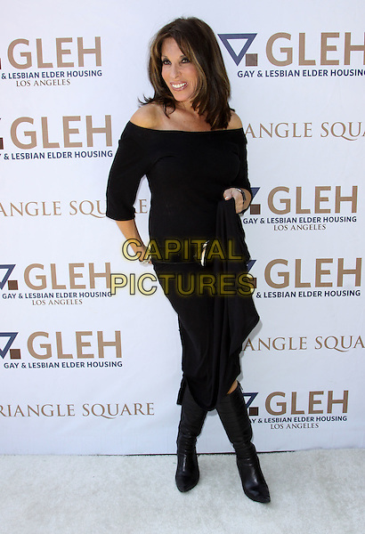 KATE LINDER .8th Annual GLEH Garden Partyheld At A Private Residence, Los Angeles, California, USA, .11th October 2009..full length black off the shoulder shoulders top jumper sweater skirt boots knee high .CAP/ADM/KB.©Kevan Brooks/AdMedia/Capital Pictures.