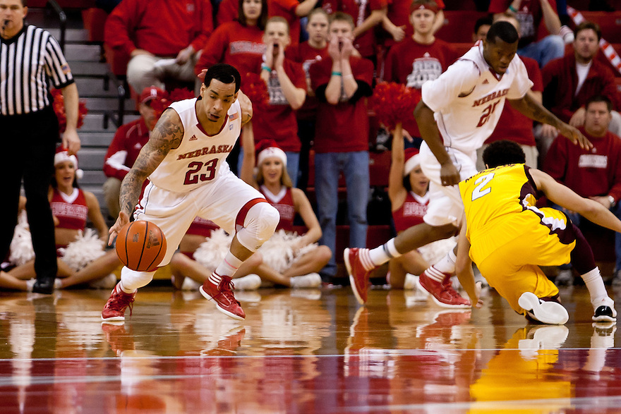 20 December 2011: Bo Spencer #23 of the Nebraska Cornhuskers gets the ball away from Austin McBroom #2 of the Central Michigan Chippewas during the first half at the Devaney Sports Center in Lincoln, Nebraska. Nebraska defeated Central Michigan 72 to 69.