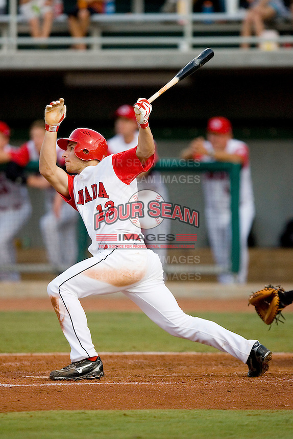 Brett Lawrie #13 of Team Canada follows through on his swing versus Team USA at the USA Baseball National Training Center, September 4, 2009 in Cary, North Carolina.  (Photo by Brian Westerholt / Four Seam Images)