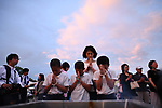 HIROSHIMA, JAPAN - AUGUST 06: Visitors pray for the atomic bomb victims in front of the cenotaph at the Hiroshima Peace Memorial Park in Hiroshima, Western Japan on August 6, 2019. Japan marks the 74th anniversary of the first atomic bomb that was dropped by the United States on Hiroshima on August 6, 1945. The bomb instantly killed an estimated 70,000 people and thousands more in coming years from radiation effects. Three days later the United States dropped a second atomic bomb on Nagasaki which ended World War II.  (Photo: Richard Atrero de Guzman/ Aflo)