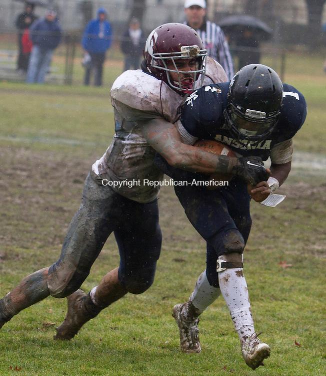 ANSONIA, CT.- 06 DECEMBER 2014 - 120614JW04 - Ansonia #1 Jaiquan McKnight runs the ball as Windham #20 Gilberto Torres during the Class S Large semifinal game at Jarvis Field Saturday afternoon. Ansonia won 35-14.<br /> Jonathan Wilcox Republican-American