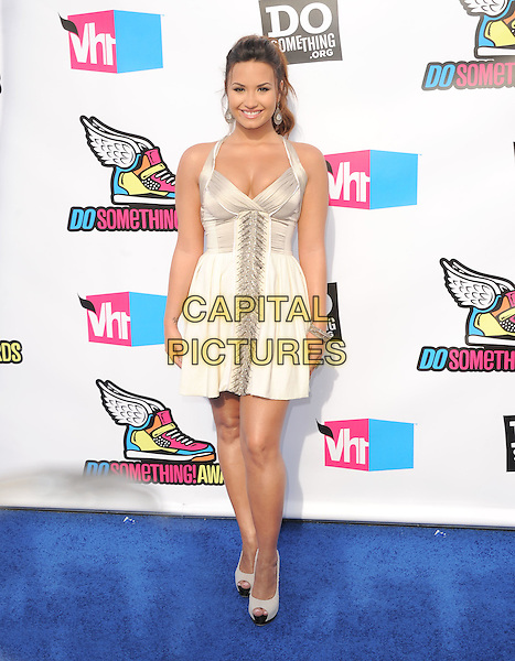 Demi Lovato.The 2011 Do Something Awards held at The Palladium in Hollywood, California, USA..August 14th, 2011.full length white dress silk satin                                                              .CAP/RKE/DVS.©DVS/RockinExposures/Capital Pictures.