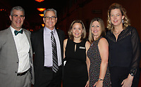 NWA Democrat-Gazette/CARIN SCHOPPMEYER Maury Peterson, Northwest Arkansas Children's Shelter executive director (center), with board members Arist Mastorides, Chris Lamson, Lori Collins and Erik Zubriski welcome guest to the 2017 Starlight Gala on March 4 at the John Q. Hammons Center in Rogers.