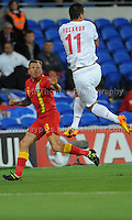 Craig Bellamy of Wales and Cardiff City challenges Kolarov of Serbia and Manchester City for a high ball during the Wales v Serbia FIFA World Cup 2014 Qualifier match at Cardiff City Stadium, Cardiff, Wales -Tuesday 10th Sept 2014. All images are the copyright of Jeff Thomas Photography-07837 386244-www.jaypics.photoshelter.com