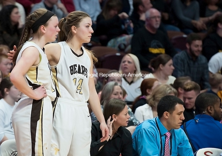 UNCASVILLE, CT--- -031916JS16- Thomaston's Morgan Sanson, right, gives a pat on the back to teammate Gabrielle Hurlbert after she fouled out of their Class S state championship game against Canton Saturday at Mohegan Sun Arena. Sanson had fouled out a few minutes earlier. <br /> Jim Shannon Republican-American