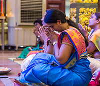 Hindu Temple, Sri Maha Mariamman, Worshiper Praying during Navarathri Celebrations, George Town, Penang, Malaysia.