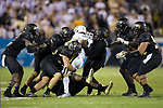 Nathan Cottrell (31) of the Georgia Tech Yellow Jackets is surrounded by Grant Dawson (50) and the Wake Forest Demon Deacons defense during second half action at Bobby Dodd Stadium on October 21, 2017 in Atlanta, Georgia.  The Yellow Jackets defeated the Demon Deacons 38-24. (Brian Westerholt/Sports On Film)
