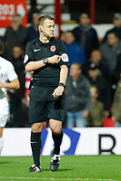 Referee, Stuart Attwell during the Sky Bet Championship match between Brentford and Leeds United at Griffin Park, London, England on 4 November 2017. Photo by Carlton Myrie.
