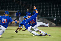AZL Cubs third baseman Cam Balego (82) collides with relief pitcher Eury Ramos (81) and first baseman Luis Hidalgo (18) during a game against the AZL Giants on September 6, 2017 at Sloan Park in Mesa, Arizona. AZL Giants defeated the AZL Cubs 6-5 to even up the Arizona League Championship Series at one game a piece. (Zachary Lucy/Four Seam Images)