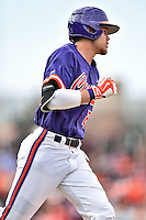 Clemson Tigers right fielder Seth Beer (28) runs to first during a game against the South Carolina Gamecocks at Fluor Field on March 5, 2016 in Greenville, South Carolina. The Tigers defeated the Gamecocks 5-0. (Tony Farlow/Four Seam Images)