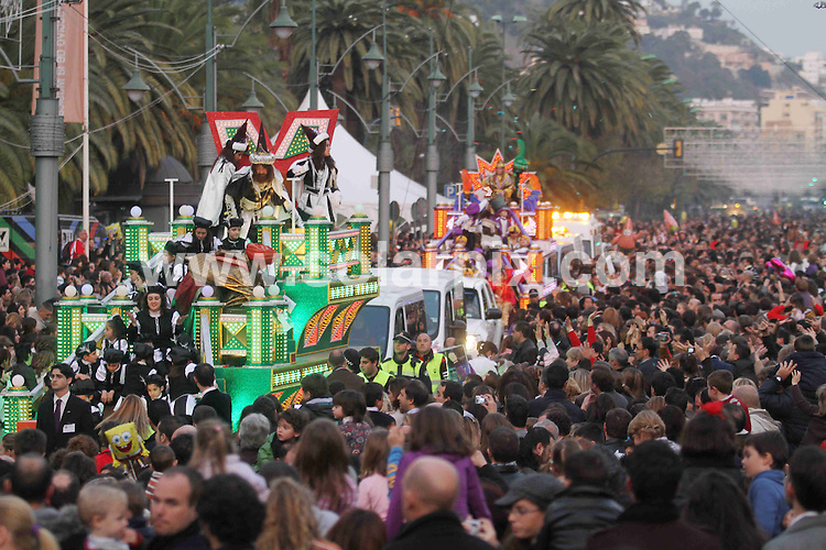 **ALL ROUND PICTURES FROM SOLARPIX.COM**                                             **WORLDWIDE SYNDICATION RIGHTS EXCEPT SPAIN & SOUTH AMERICA - NO SYNDICATION IN SPAIN OR SOUTH AMERICA**                                                                                  Caption: Scenes from the Los Reyes Magos parade in Malaga. Every year on the 6th of January, the three magic kings appear all over Spain, bringing presents to children in their homes during the night - much like Santa on the 24th / 25th December in other countries - and throwing sweets and gifts to the crowds. Malaga, Spain. 6 January 2011                                                                             This pic: Three Kings Parade                                                                                             JOB REF: 12643 MPA       DATE:  06_01_2011                                                          **MUST CREDIT SOLARPIX.COM OR DOUBLE FEE WILL BE CHARGED**                                                                      **MUST AGREE FEE BEFORE ONLINE USAGE**                               **CALL US ON: +34 952 811 768 or LOW RATE FROM UK 0844 617 7637**