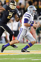 Kansas State quarterback Jake Waters (15) rushes with the ball during an NCAA football game, Saturday, December 06, 2014 in Waco, Tex. (Mo Khursheed/TFV Media via AP Images)
