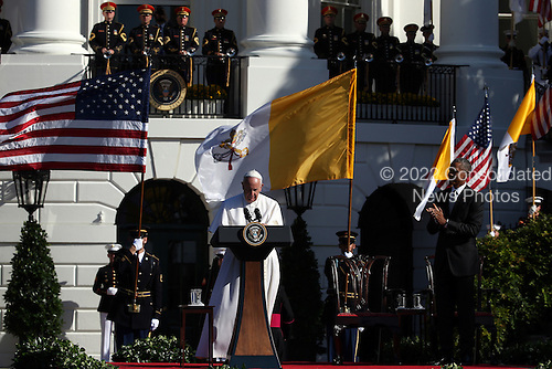 Pope Francis (C) speaks with U.S. President Barack Obama (R) during the arrival ceremony at the White House on September 23, 2015 in Washington, DC. The Pope begins his first trip to the United States at the White House followed by a visit to St. Matthew's Cathedral, and will then hold a Mass on the grounds of the Basilica of the National Shrine of the Immaculate Conception.  <br /> Credit: Win McNamee / Pool via CNP