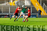 Any ones ball as Fintan Coffey of Fossa and Mikey Boyle of Ballyduff tussle for possesion as Fossa's Anthony O'Keeffe is ready to join in the action in the Junior Premier Football Club Championship.