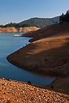 Water in Shasta Lake Reservoir at one of it's lower levels during a drought year, near Redding, California