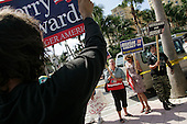 West Palm Beach, Florida.USA.October 29, 2004..Pro Kerry and Pro Bush people square just out side a Kerry rally.