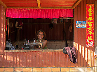 A women tailer along the rural road outside Battambang, Cambodia