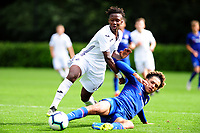 Tivonge Rushesha of Swansea City battles with Johnathon Russell of Chelsea during the Premier League u18 match between Swansea City AFC and Chelsea FC at Landore Training Ground, Wales, UK. Tuesday 11th September 2018