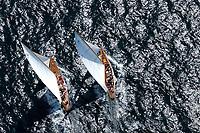Kieler Woche:EUROPA, DEUTSCHLAND, SCHLESWIG- HOLSTEIN 22.06.2005:Kieler Woche, 12er Yachten hart am Wind in der Kieler Förde. Diese beiden Schiffe zeigen in ihrem Match Race die klassische Rumpfform. Die linke Yacht mit dem Segelkennzeichen K10 hat die rechte Yacht mit dem Segelkennzeichen D1 im Lee überholt. Trivia, Thea, <br />Luftaufnahme, Luftbild,  Luftansicht