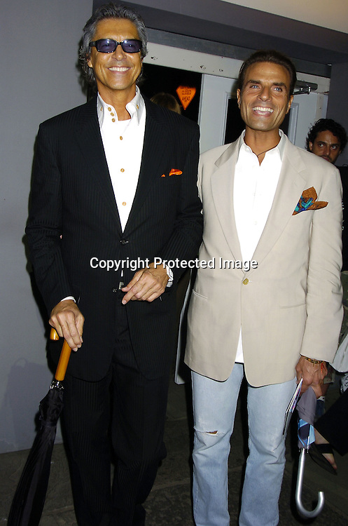 Tommy Tune and friend ..at the Fashion For Relief Fashion Show Benefit on September 16, 2005 at The Tents at the Olympus Fashion Week with money to be donatted to AmeriCares. ..Photo by Robin Platzer, Twin Images