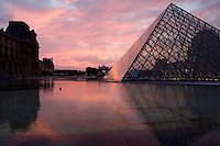 PARIS, FRANCE - AUGUST 26 : A general view of the pyramid at the Louvre museum at twilight on August 26, 2007 in Paris, France. The pyramid was designed by the American architect I M Pei and opened to the public in 1989 for the bicentennial of the French Revolution. Built of 666 glass lozenges on a steel frame, the pyramid forms the main entrance of the Louvre museum. ((Photo by Manuel Cohen)