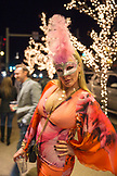 USA, Colorado, Aspen, a woman out front of the Jerome Hotel is dressed for a masquerade party