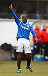 Sone Aluko salutes the Rangers fans after his wonder strike
