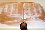 A picture depicting a 1,000-year-old parchment from a Hebrew bible manuscript is screened during a news conference at Jerusalem's Yad Ben-Zvi institute December 2, 2007. The institute said last month the scrap of paper, the size of a credit card, forms part of the 10th century Aleppo Codex, viewed by scholars as one of the most authoritative manuscripts of the Hebrew bible. The parchment was kept as a lucky charm by Sam Sabbagh, a Syrian Jew who in 1947 plucked it from the floor of an Aleppo synagogue that was torched after a United Nations decision to partition Palestine, paving the way for the creation of Israel..Photo by Daniel Bar-On/Jini